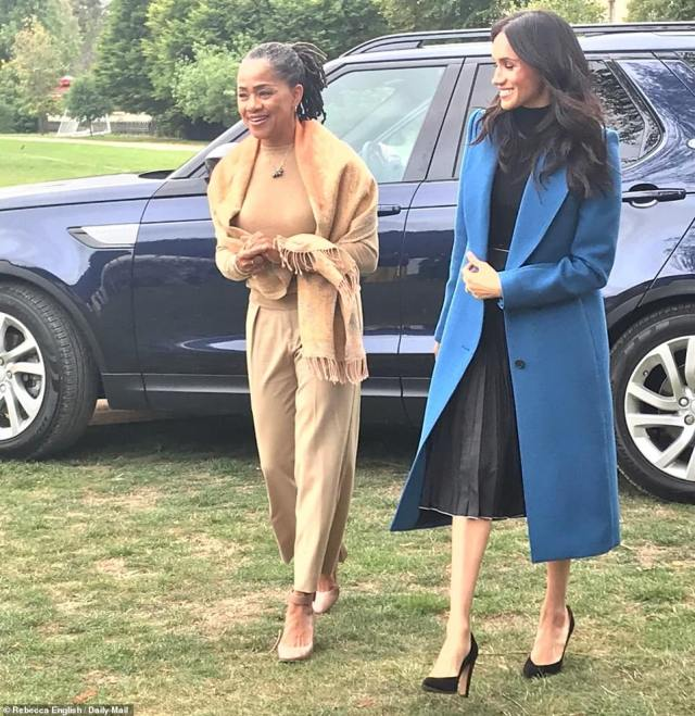 Meghan Markle and her mother Ms Ragland beamed as they got out of a car at Kensington Palace this afternoon