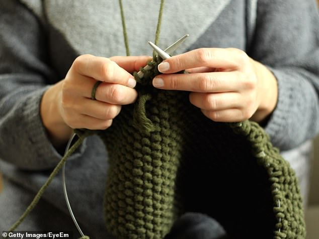The meditative action of a hobby such as knitting can help you feel calmer and clear your mind, leaving you feeling sharper in the long run (stock image)