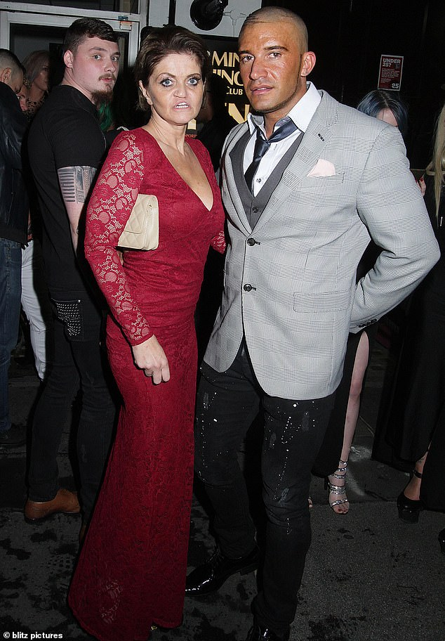 Pals: Daniella posed for a snap with a male friend who was clad in a fitted grey suit jacket and paint spattered jeans