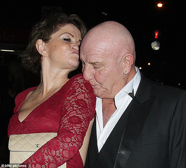 Mwah: The man responded to her advances by giving her a kiss on the shoulder