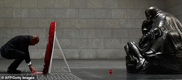 Turkish President Recep Tayyip Erdogan lays down a wreath at the Neue Wache (New Guardhouse) memorial for the victims of war and dictatorship on September 28