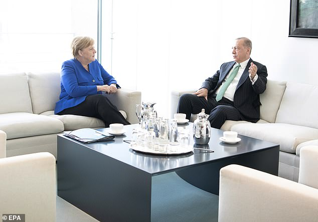 Turkish President Recep Tayyip Erdogan (R) and German Chancellor Angela Merkel (L) sit for talks at the Chancellery in Berlin