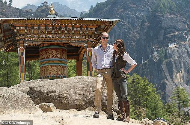 April, 2016: Posing at Bhutan's famous Tiger's Nest monastery, Kate beams  at William. On her feet are the Penelope Chilvers boots, which she wore on the three-hour hike to the beauty spot