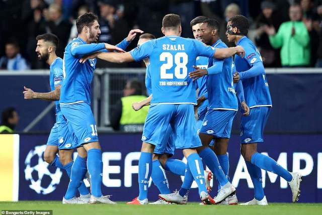 Hoffenheim players surround their goalscorer Belfodil after taking an early lead in Tuesday's Champions League group tie