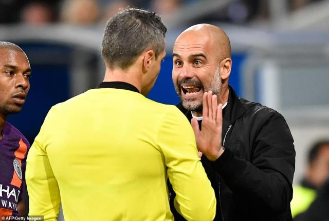 Pep Guardiola appears unhappy with a decision from referee Damir Skomina as they argue on the edge of his technical area