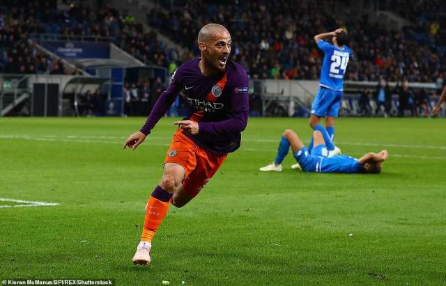 David Silva of Manchester City celebrates scoring a goal that would prove to be the winner in the Champions League match