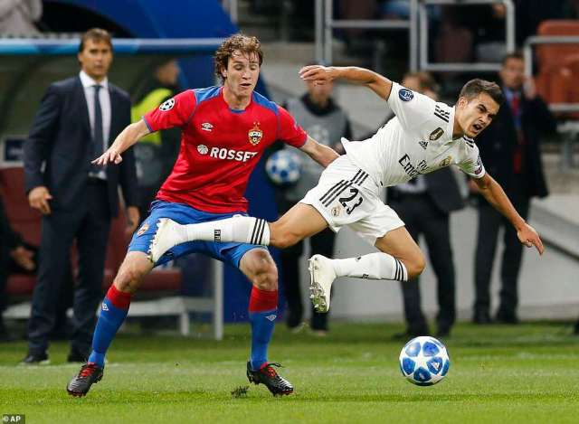 CSKA defender Mario Fernandes challenges for possession of the ball with Madrid youngster Sergio Reguilon
