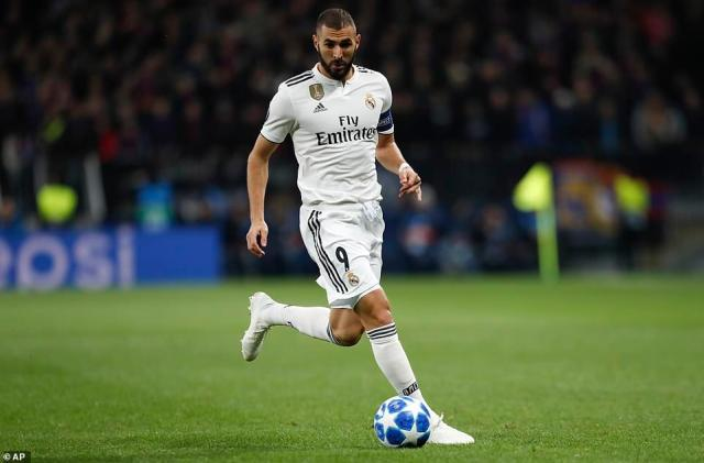French striker Karim Benzema looks to inspire his team towards an equaliser midway through the opening period