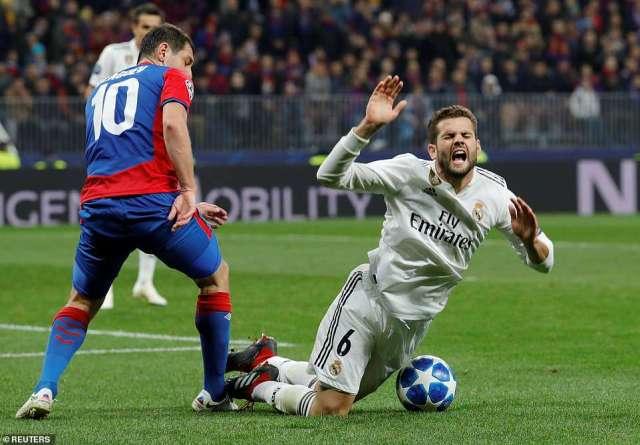 Madrid defender Nacho goes down under a challenge from Alan Dzagoev during the second half