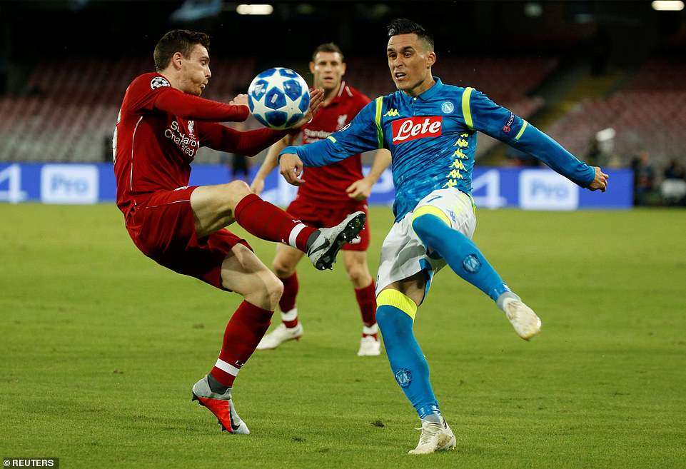 Liverpool's Andrew Robertson competes for the ball against Napoli forward Jose Callejon during the opening 45 minutes