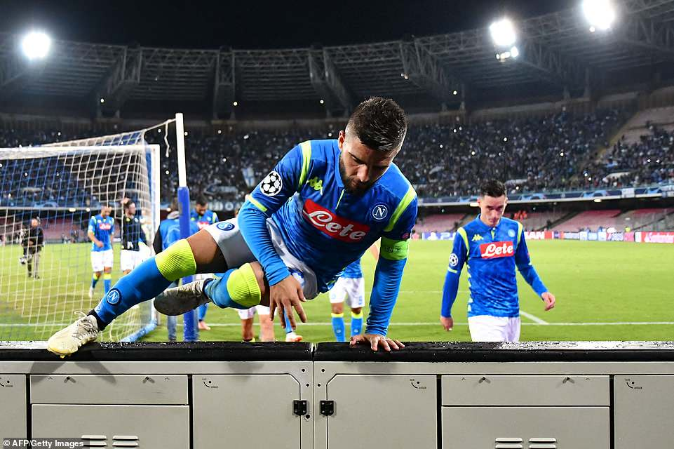 Insigne and his Napoli team-mates climb over the advertising barriers after full-time to celebrate with their supporters