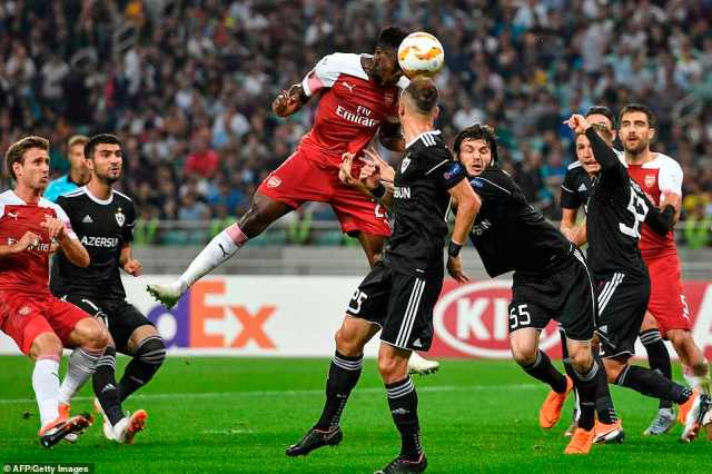 Danny Welbeck meets a corner but heads the ball just wide of the right post with Arsenal looking for a second goal