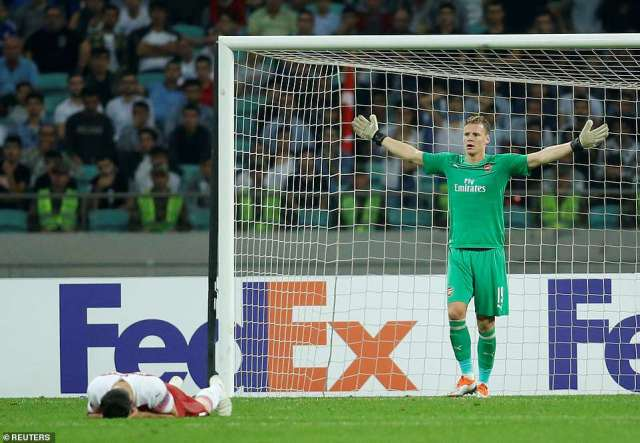 The German goalkeeper gestures to the referee while defender Sead Kolasinac lays on the ground with a head injury