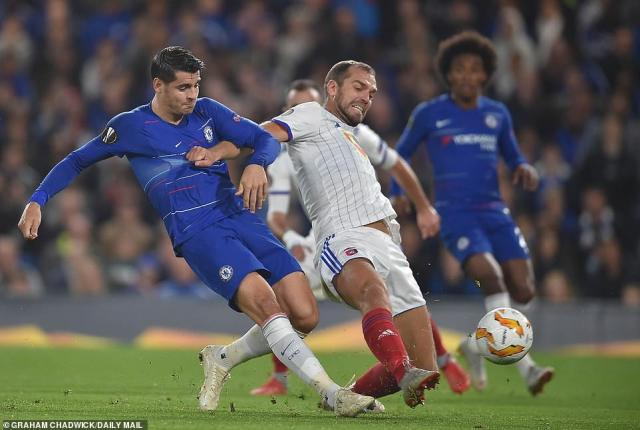 Alvaro Morata manages to find enough room to get a shot away but he fails to score past Vidi goalkeeper Tomas Tujvel
