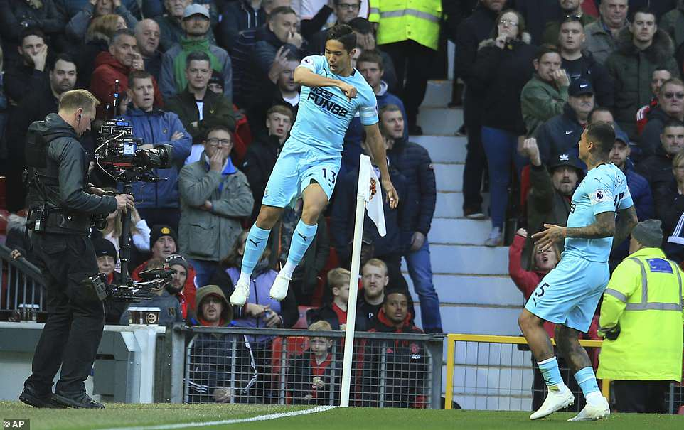 Muto jumps for joy as his goal extends Newcastle's lead against a struggling United side during the Premier League clash