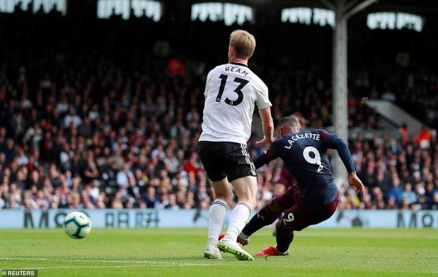 Alexandre Lacazette piled more misery on Fulham's defence as he opened the scoring for Arsenal  at Craven Cottage