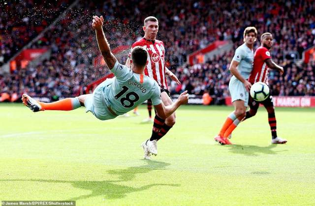 Giroud acrobatically volleyed the ball across the face of goal after a free kick from Willian (out of shot) had been played to him