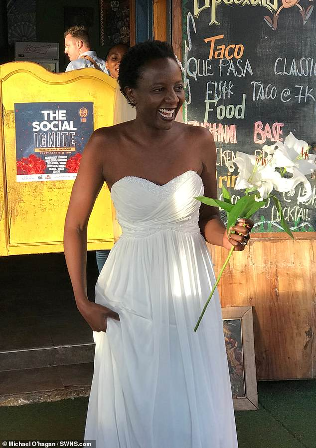 Lulu on her 'wedding' day. The student arranged the last-minute ceremony at Quepasa Bar in the Ugandan capital Kampala on August 27 - her 32nd birthday