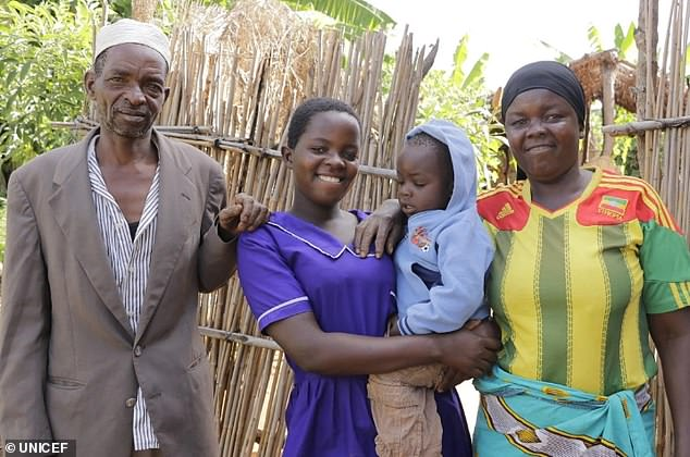 Edna and her parents and baby at their home in Mkumbira village in Mangochi. She says she 'no longer bothers with boys' and pours her energy into school work instead