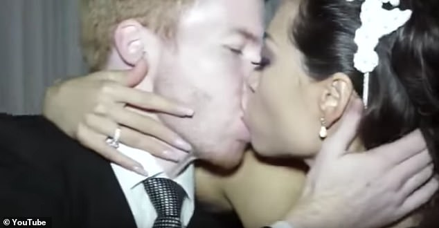 Close: The pair are filmed kissing passionately after exchanging vows in another scene from their upbeat wedding video