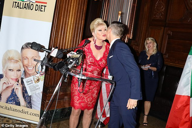 Ivana Trump and Gianluca Mech embrace at a launch for their Italiano Diet collaboration in New York in June 2018