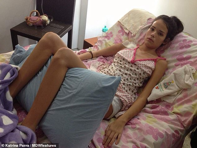 After overcoming blood poisoning, Ms Parra's symptoms continued, leaving doctors  baffled. Due to her not receiving proper treatment, her condition deteriorated until she could not move. She is pictured in hospital with her legs raised to keep circulation to her limbs moving