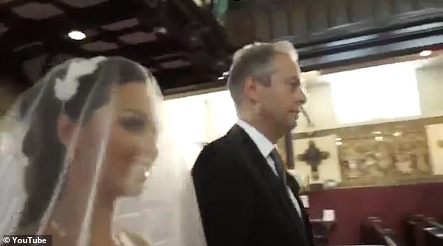 Here she comes: Katya is seen entering the church with her father Andrey Sokolov ahead of her wedding to fellow dancer Neil