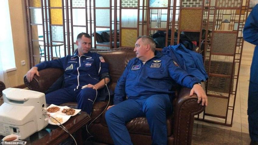 Roskosmos cosmonaut Alexey Ovchinin and astronautNick Haig pictured in the immediate aftermath of the terrifying incident. The pair are now in Zhezkazgan Kazakhstan and are being examined for any injuries or medical conditions arising from the 'ballistic descent'