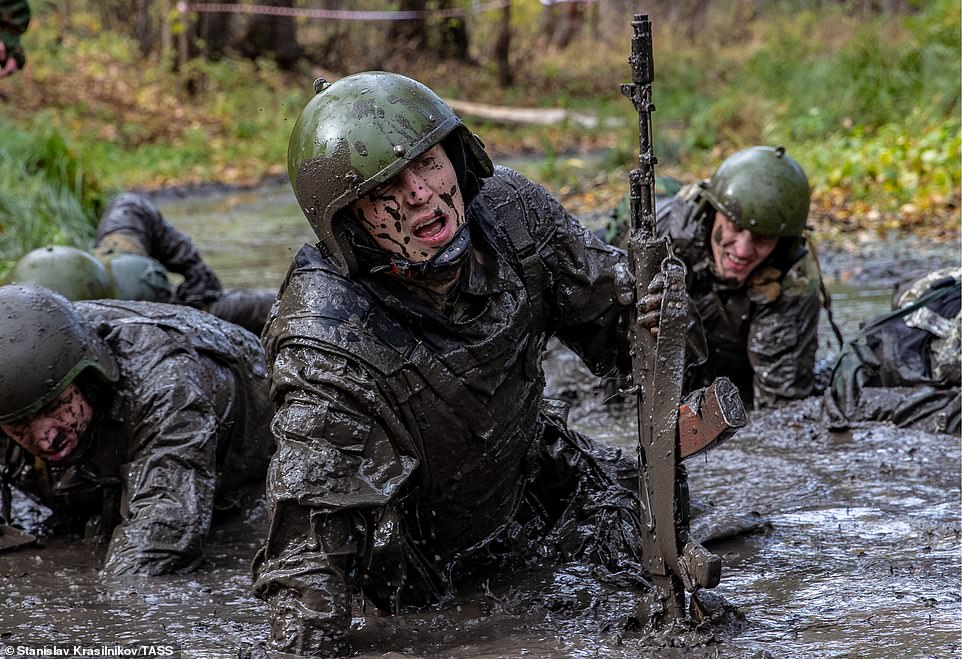 Contenders crawl through chest-high swamps of mud and stagnant water during a brutal five-mile cross country race
