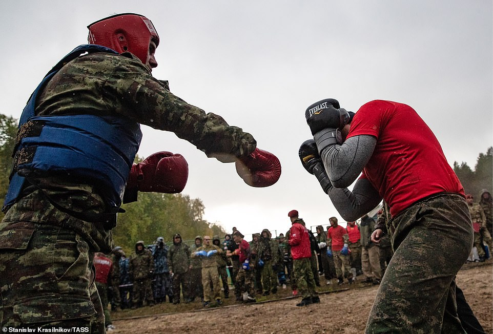 A soldier blocks a punch launched at his head during the final and most dreaded part of the endurance test