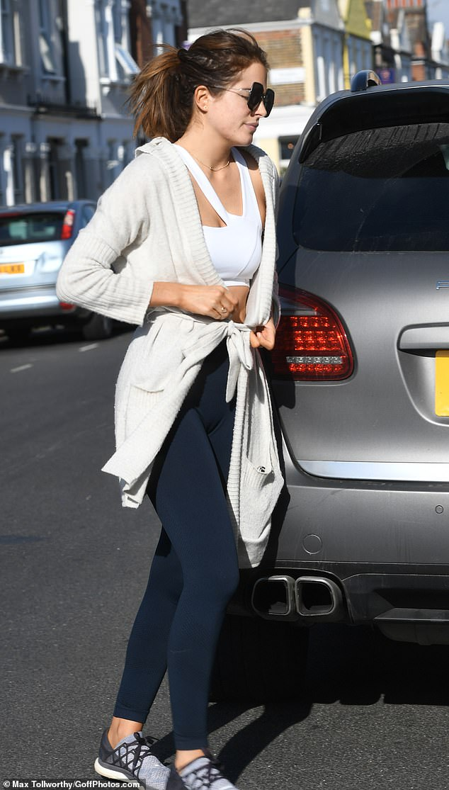 Natural beauty:The mother-of-one swept her dark tresses back into a tousled ponytail and appeared to go make-up free