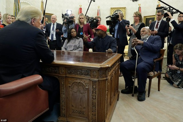 Talking: Kanye West hit his hand on the Resolute Desk to make a point during his talks with Trump