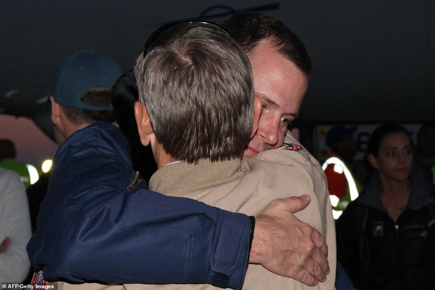 Astronaut Nick Hague was greeted upon his return by family members and officials after today's botched launch