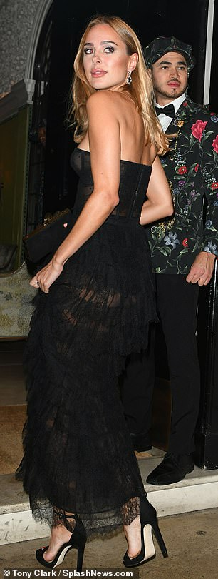 Sultry: Kimberley Garner flashed her bare chest and underwear as she attended the International Day Of Girl Gala at Annabel's in London on Thursday evening