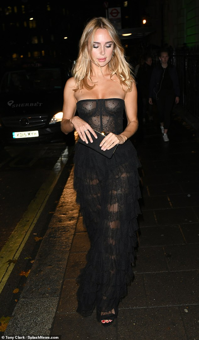 Show-stopper: The former Made In Chelsea, 28, left little to the imagination as she donned a sheer mesh corset dress, putting her sensational figure on full display