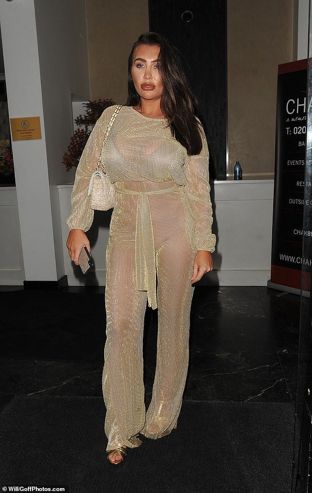 Daring: Lauren Goodger left nothing to the imagination in a sheer jumpsuit at Chak89 restaurant in London on Thursday night