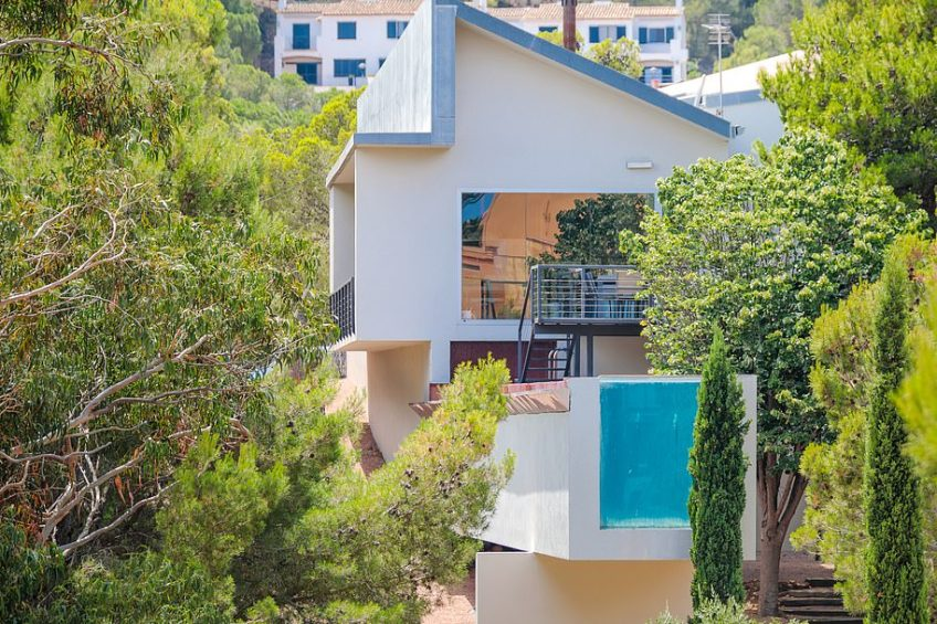 'This three-bedroom property - just a few steps away from Aigua Xelida beach - boasts beautiful views of the Mediterranean and the surrounding pine forest hillside,' says Lucas Fox, which is selling it