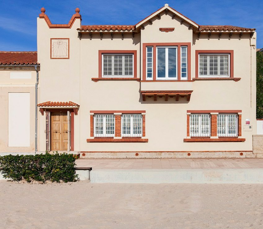 This house sits right on Sant Salvador beach and is described as a 'dream home'