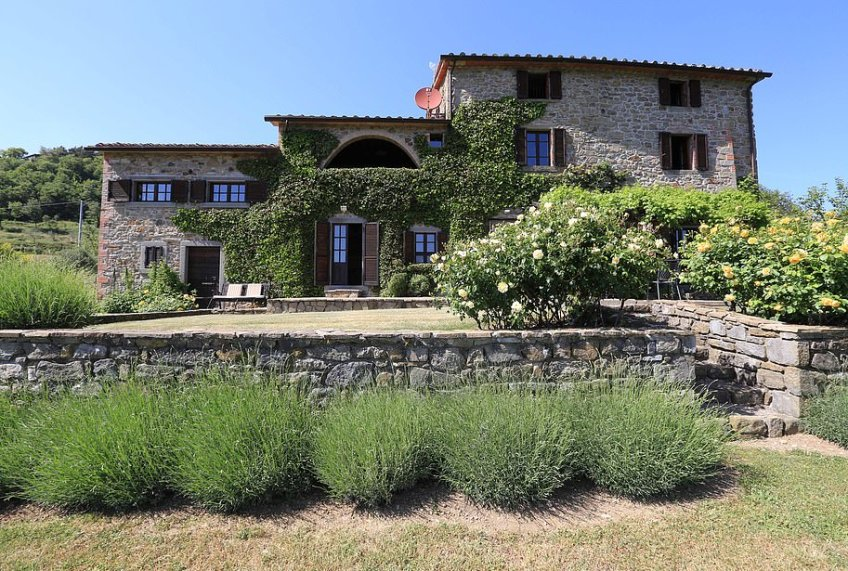This wonderful farmhouse has 'enviable south facing views' and 'pristine' gardens