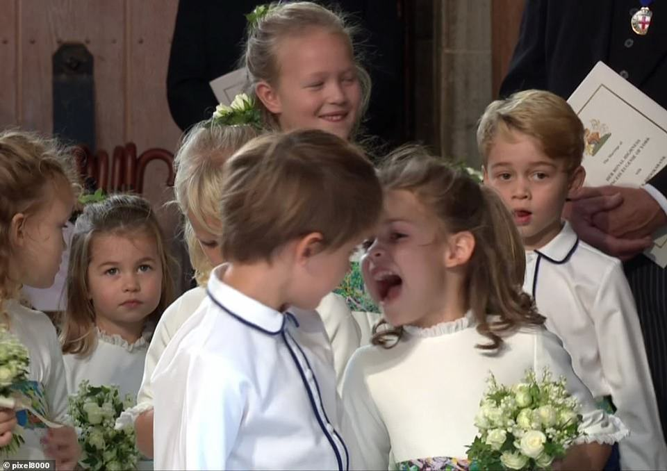 Robbie Wiliams daughter Theodora (front right) looked to be enjoying her big moment as she chatted enthusiastically to one of the page boys at St George's Chapel