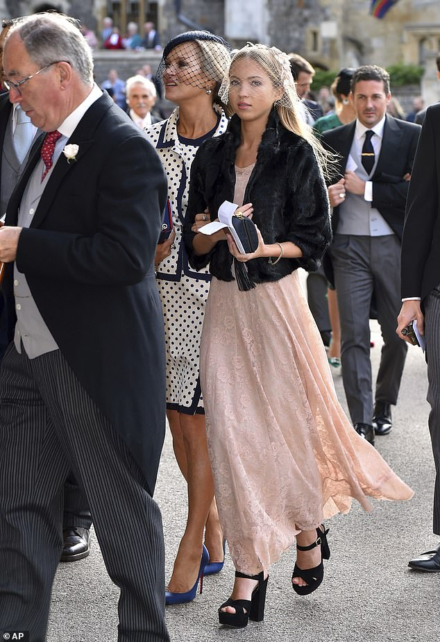 Model mates: Lila nailed her youthful yet sophisticated wedding style as she wore a billowing pink dress comprising of lace material and an ankle skimming hemline
