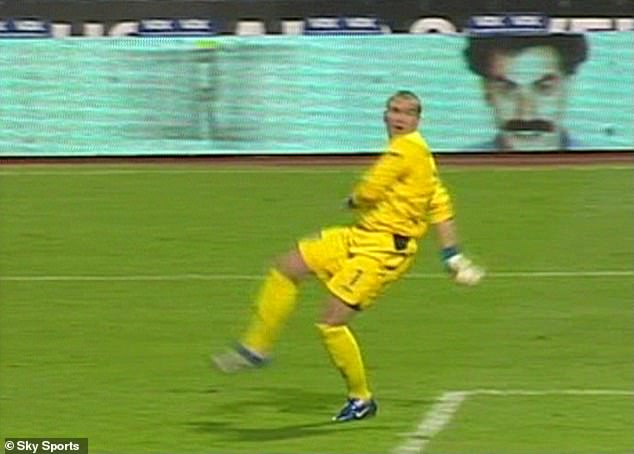 Robinson can only watch on in horror (along with Borat) as the ball trickles into the net