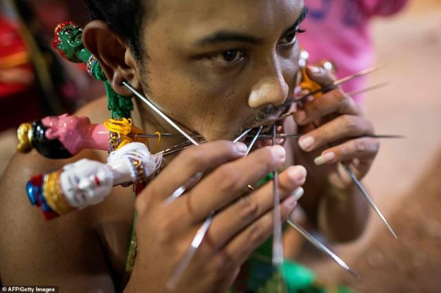 Locals believe the men taking part in the piercing rituals become gods descending down to Earth, and by piercing themselves with objects they  purify themselves, taking on the sins of the community