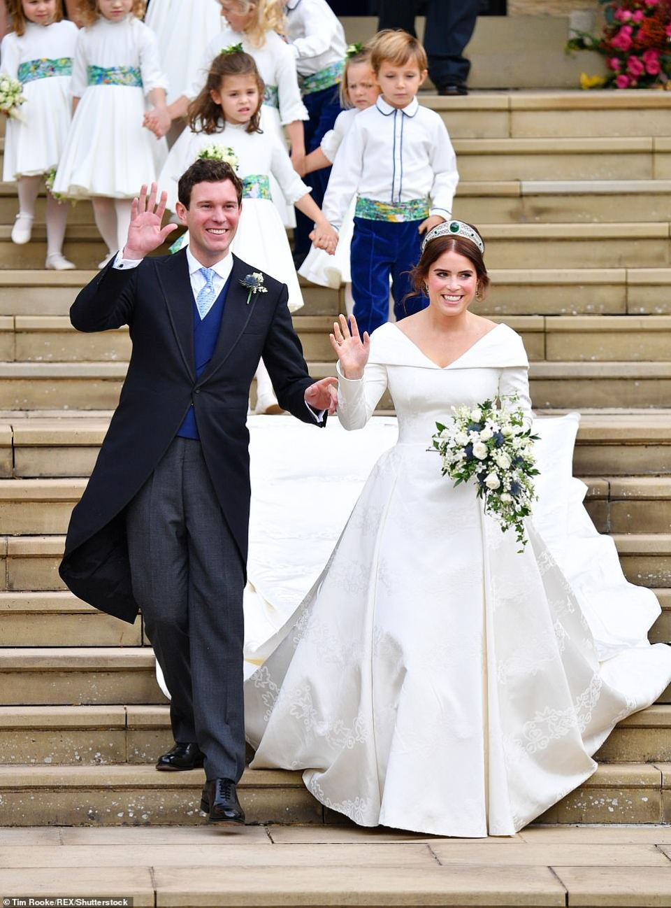 Theodora Williams and Louis de Givenchy held hands as they led the bridal party out of St George's Chapel behind Eugenie and Jack this afternoon