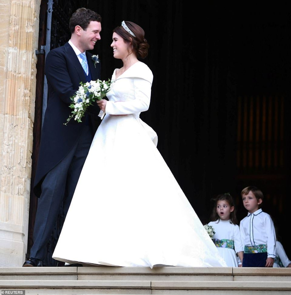 It's a big day! Theodora Williams looked a little surprised as she made her way out of the church hand-in-hand with Louis de Givenchy (right) behind the happy couple Eugenie and Jack