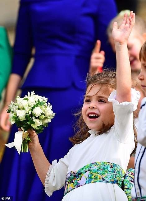 Cute! Theodora Williams enthusiastically waved off the newlyweds as they departed for their carriage procession