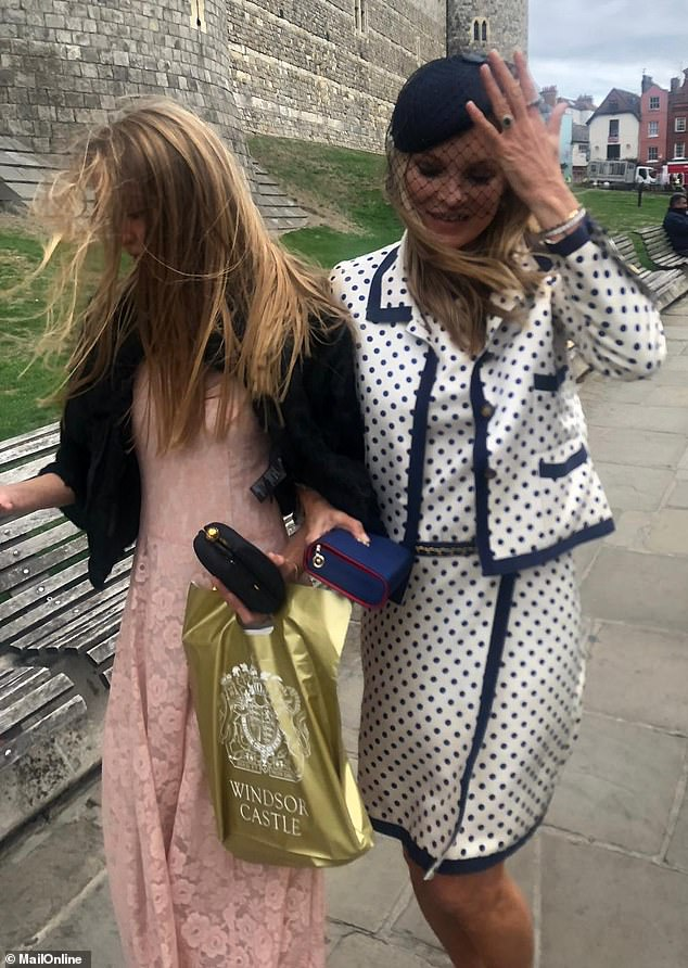 Happy days: Kate Moss was clearly honoured to have scooped her invite as she described the wedding as 'great and beautiful' to MailOnline, while leaving St George's Chapel at Windsor Castle, where she was joined by her daughter Lila, 16
