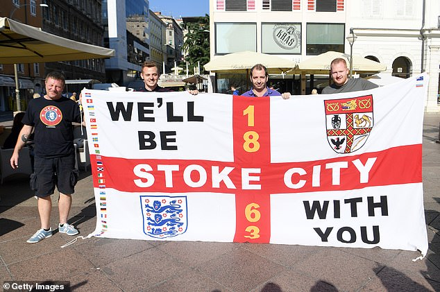 A group of proud Stoke City and England supporters show off their colours in Rijeka