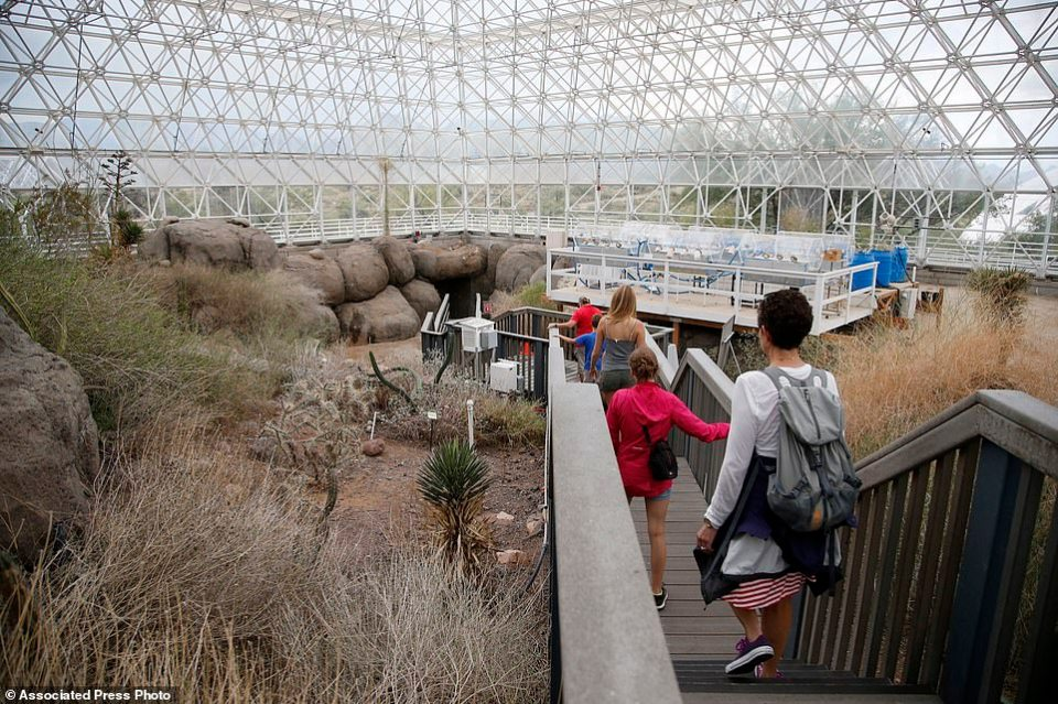Tourists walk through the enclosed coastal fog desert ecosystem of the Biosphere 2 in Oracle, Ariz. Biosphere 2 lives on as a successful research site 25 years after eight people emerged from the New Age-style experiment in the Arizona desert.