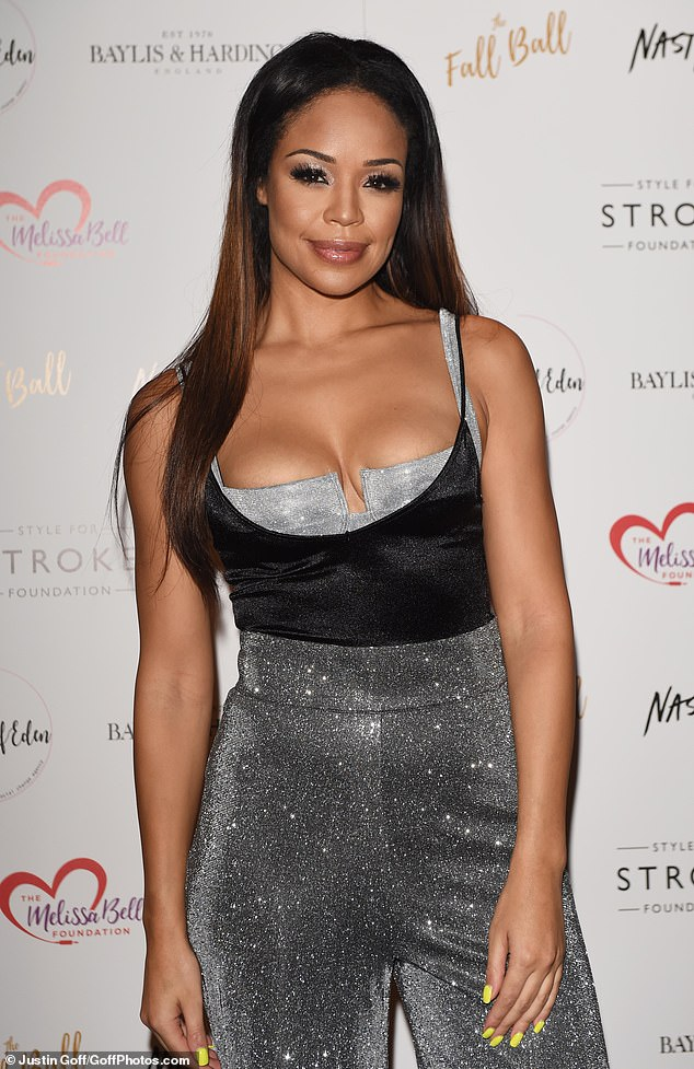 Glamorous: She showed off her figure in a low-cut black top with a silver bustier